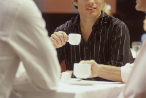 Men Sitting at Table Drinking Espresso